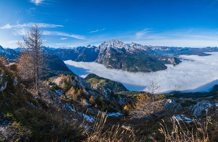 Autumn Alps mountain misty morning view from Jenner Viewing Platform, Schonau am Konigssee, Berchtesgaden national park, Bavaria, Germany.  Picturesque traveling, seasonal and nature beauty scene. Фото со стока - 139860915