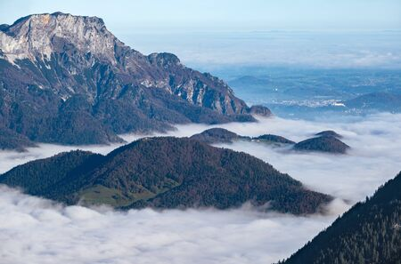 Autumn Alps mountain misty morning view from Jenner Viewing Platform, Schonau am Konigssee, Berchtesgaden national park, Bavaria, Germany.  Picturesque traveling, seasonal and nature beauty scene.
