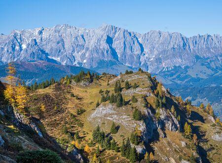 Sunny idyllic autumn alpine scene. Peaceful Alps mountain view from hiking path from Dorfgastein to Paarseen lakes, Land Salzburg, Austria. Picturesque hiking seasonal, nature beauty concept scene.