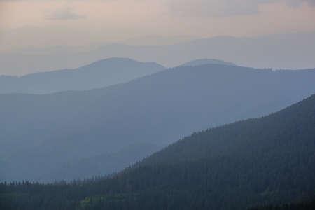 Summer misty evening mountain tops silhouettes. Marmaros, Carpathian, Ukraine. Stock Photo