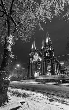 Grayscale. Beautiful illuminated night winter Church of Sts. Olha and Elizabeth in Lviv, Ukraine. Built in the years 1903-1911.