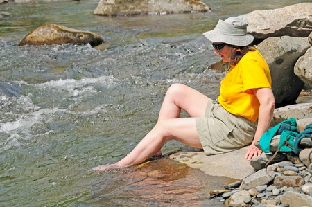 Cooling ones feet on a hot day in the wilderness photo