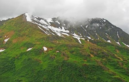 Fog on the hills of Kodiak Island in Alaska Stock Photo