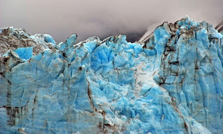 serac: Blue ice of the Childs Glacier in afternoon clouds.  This glacier is found near Cordova, Alaska
