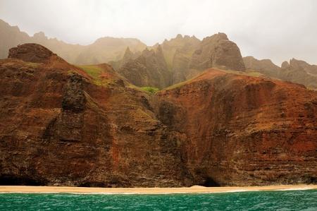 Dramatic cliffs in the mist on the Na Pali coast on the Hawaiian Island of Kauai