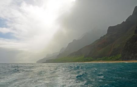 na: This is the Na Pali coast on Kauai as the morning mist breaks Stock Photo