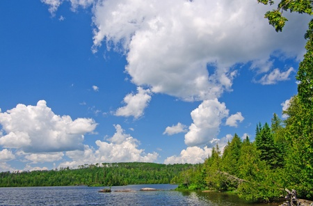 Afternoon clouds over Cherokee Lake in the Boundary Waters Stock Photo - 12574874