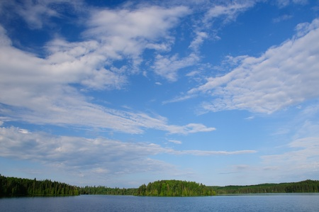 long lake: Summer clouds over Long Island Lake in the Boundary Waters Stock Photo