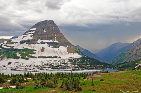 Storm moving onto Bearhat Mountain in Glacier National Park Stock Photo - 13128726