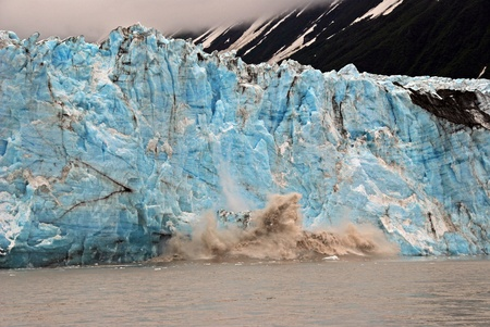 calving: Blue ice of the Childs lacier calving into the Copper River near Cordova, Alaska