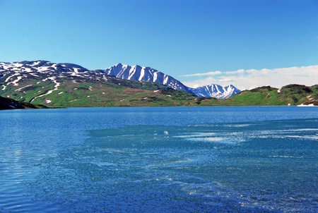 lost lake: Ice breakup on Lost Lake near Seward, Alaska Stock Photo
