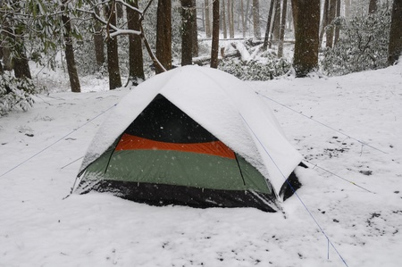 Tent in a spring snow in walnut bottoms in the Great Smoky Mountains in North Carolina photo