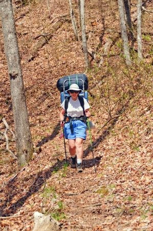 Hiker coming down the Long Hungry Ridge trail in the Smoky Mountains photo