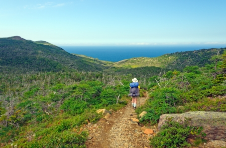 Backpacker hiking the Green Gardens trail in Gros Morne National park Stock Photo - 14997072