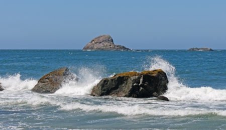 Waves Crashing on rocks in Trinidad State Beach in California photo
