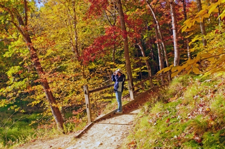 bird watcher: Bird watcher on the Strahl lake trail in Indiana