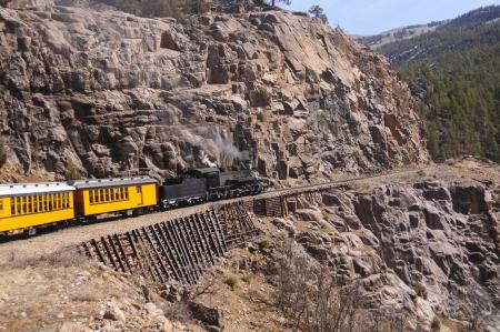narrow gauge: Steam Locomotive on mountain pass in Colorado