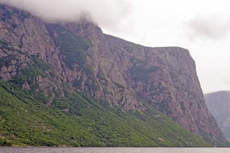 morne: Rocks of the Western Brook Pond Fjord in Gros Morne National Park Stock Photo