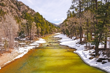 early spring snow: The Animas River in Colorado with early spring snow