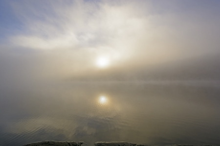 Sun Reflection on Ottertrack Lake in the Boundary Waters in Minnesota photo