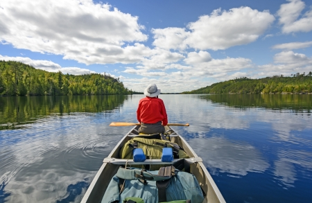 Canoer on Kekekabic Lake in the Boundary Waters in Minnesota Stock Photo