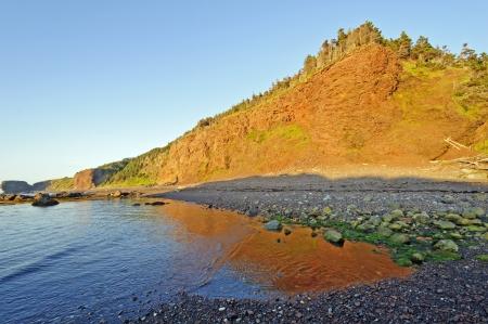 morne: Sun Glow on a Coastal Beach in Gros Morne National Park