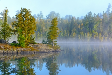 Fog and Mist on Ottertrack Lake in the Boundary Waters Stock Photo