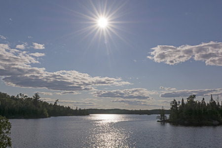 minnesota woods: High Sun over a Saganagons Lake in the Quetico
