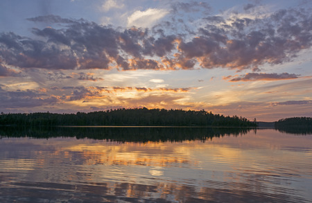 minnesota woods: Reflections at Sunset on Saganaga Lake in Quetico Provincial Park