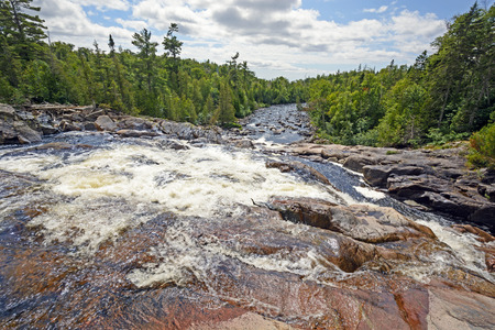 rushing water: Looking Down a Sand Creek on a Sunny Day In Lake Superior Provincial Park in Ontario