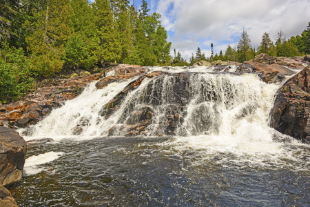 north woods: Dramatic Falls on the Sand River in Lake Superior Provincial Park in Ontario Stock Photo