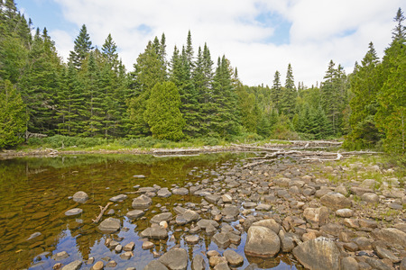 orphan: Rocks and Water on the Shallows of Orphan Lake in Lake Superior Provincial Park in Ontario Stock Photo