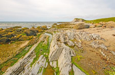 morne: Rocks and Sand on Broom Point in Gros Morne National Park in Newfoundland