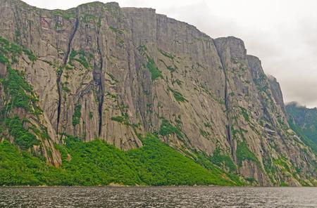 morne: Granite Cliffs of Western Brook Pond in Gros Morne National Park in Newfoundland