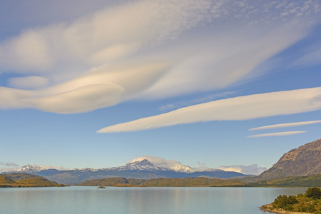 lenticular cloud: Lenticular Clouds over Lake Nordernskjold in Chilean Andes in Torres del Paine National Park in Patagonia Stock Photo