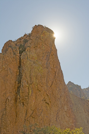 desert sun: Desert Sun Peaking Around a Rock Monolith in Big Bend National Park in Texas
