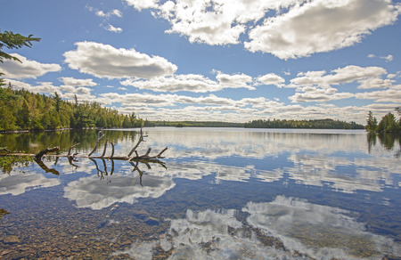 north woods: Cloud Reflections on a Calm Lake on a Sunny Fall Day in the Boundary Waters of Minnesota