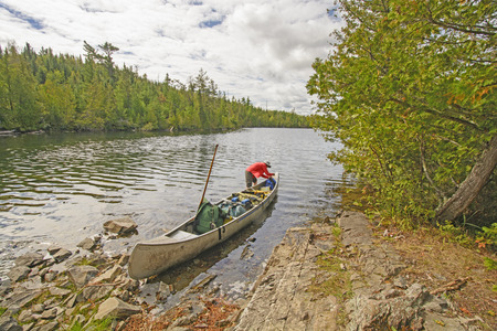 boundary: Getting the Gear set After a Portage in the Boundary Waters of Minnesota Stock Photo