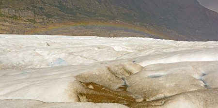 patagonian chile: Rainbow over the Grey Glacier in Torres del Paine National Park in Patagonian Chile Stock Photo