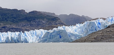 serac: Blue Ice of the Grey Glacier meeting Grey Lake in Torres del Paine National Park in Patagonian Chile