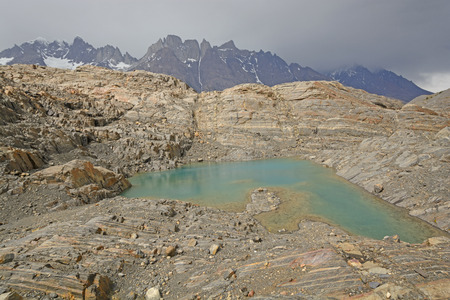 patagonian chile: Colorful Lake on a Glacial Nunatak in the Grey Glacier in Torres del Paine National Park in Patagonian Chile