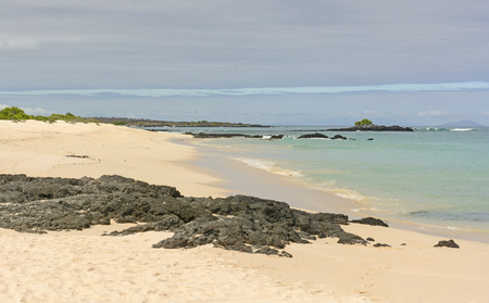 santa cruz: Morning Clouds on an the Beach of Santa Cruz Island in the Galapagos Stock Photo