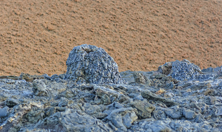 scoria: Black Spatter Cone against a Red Cinder Cone on Santiago Island in the Galapagos