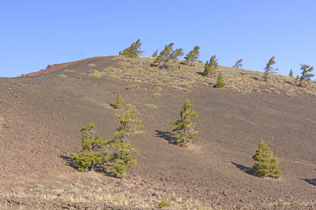 cinder: Barren Landscape on a Volcanic Cinder Cone in Craters of the Moon National Monument in Idaho