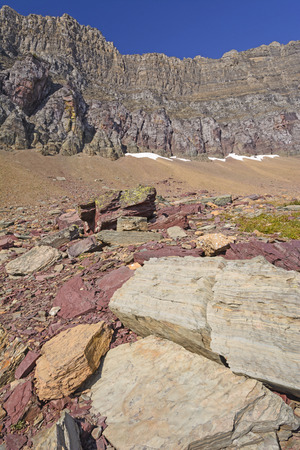 mudstone: Colorful Rocks Below a Mountain Ridge near Logan Pass in Glacier National Park in Montana