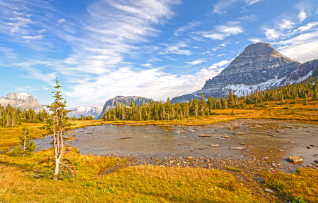 tiaga: Alpine Pond on a Mountain Pass near Logan Pass in Glacier National Park in Montana