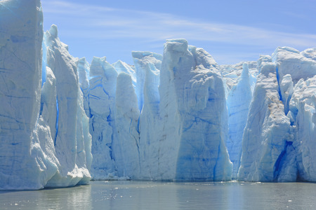 serac: Blue Ice Columns of the Grey Glacier on the Water of Grey Lake in Torres del Paine in Patagonian Chile