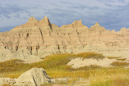 mudstone: Colorful Badlands Formations Against Stormy Skies in Badlands National Park in South Dakota Stock Photo