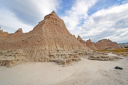 mudstone: Badlands Escarpments Against Changing Skies in Badlands National Park in South Dakota
