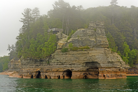 lakeshore: Fog and Mist on a Miners Point on Pictured Rocks National Lakeshore in Upper Michigan